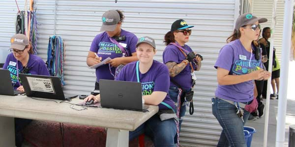 Employees at a pet adoption event