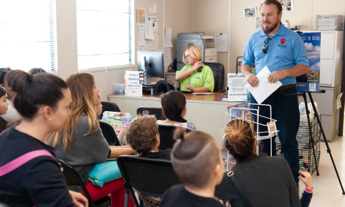 Volunteer in a classroom of students
