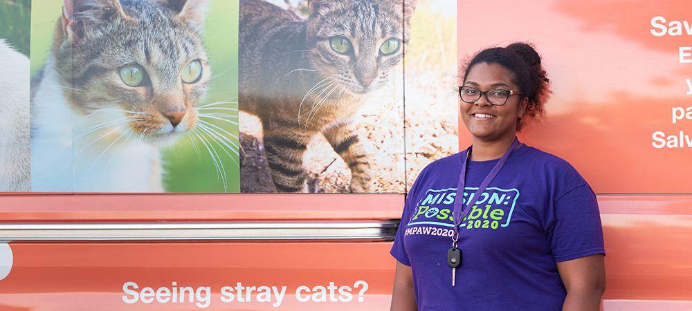 woman standing in front of community cats van